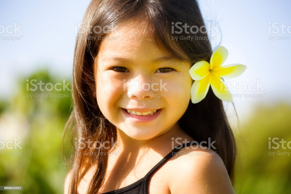 Young girl Hawaiian Polynesian Children in Tradition Clothing stock photo