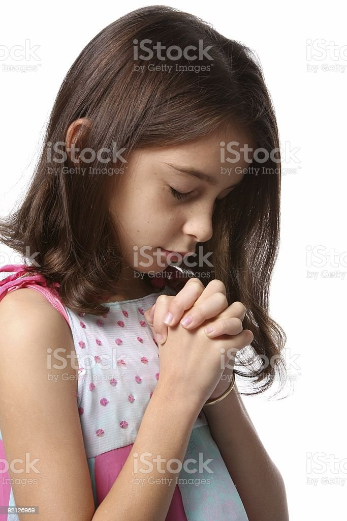Young Girl - Head Bowed in Prayer stock photo