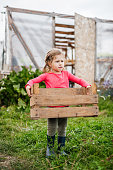 Young Girl Helping Out On Farm Carrying basket