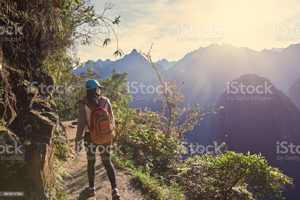 Young girl hike in beautiful landscape stock photo