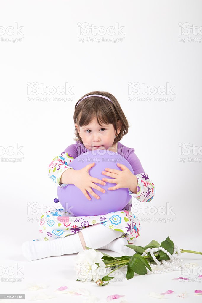 Young girl hold a balloon in her hand stock photo