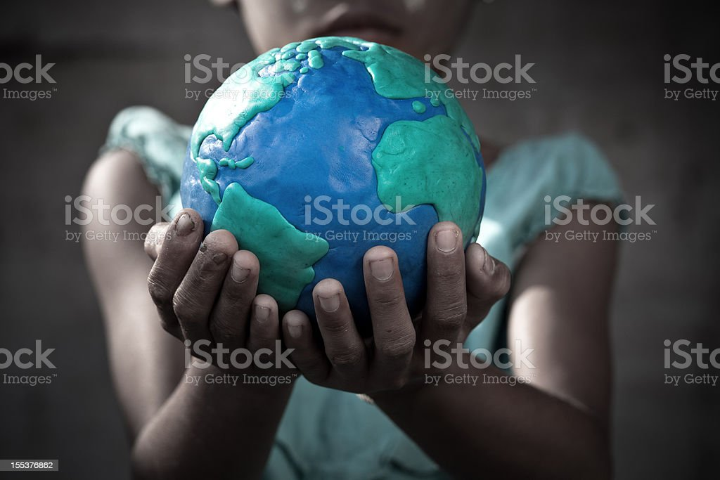 Young girl holding a globe in her hands stock photo
