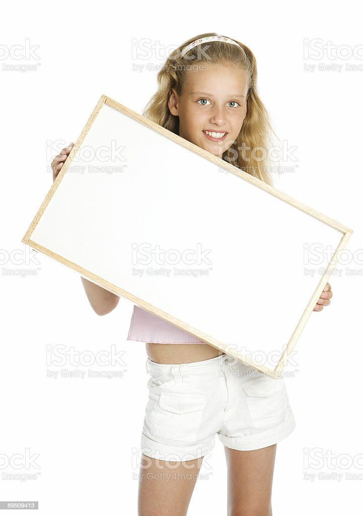 Young girl holding a white banner royalty-free stock photo