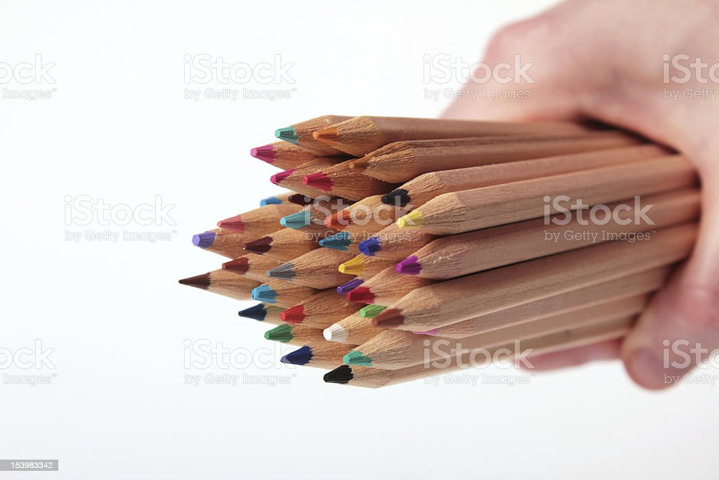 Young girl holding colorful pencils stock photo