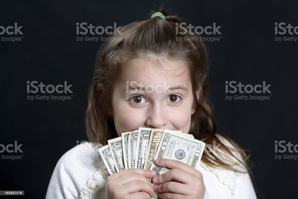 Young girl holding money on black backgroun royalty-free stock photo