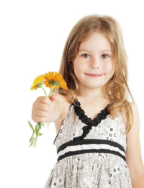 young girl holding out handful of flowers - little girls giving head stock photos and pictures