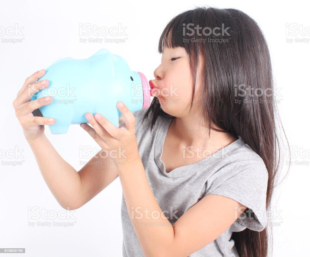 Young girl holding piggy bank photo libre de droits