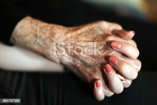 Child holdin grandma hand with love and care