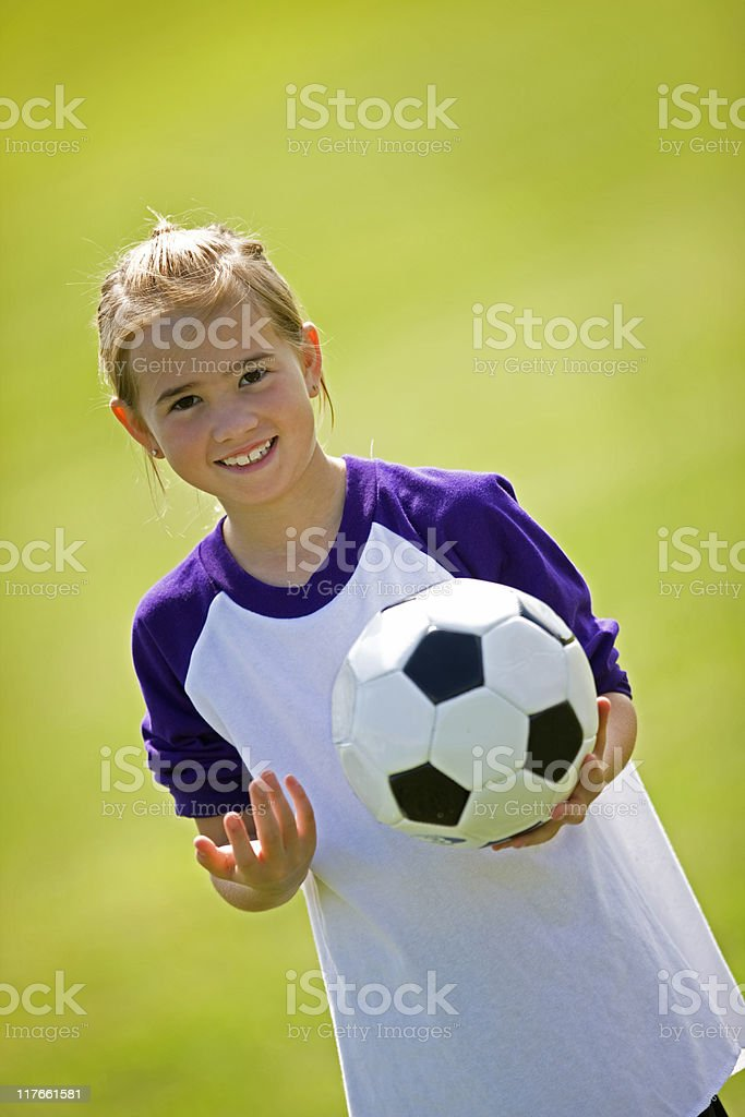Young Girl Holding Soccer Ball royalty-free stock photo