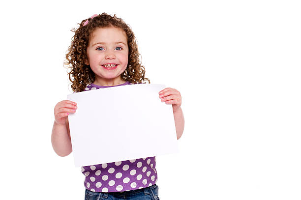 Young girl holding up a blank sign stock photo