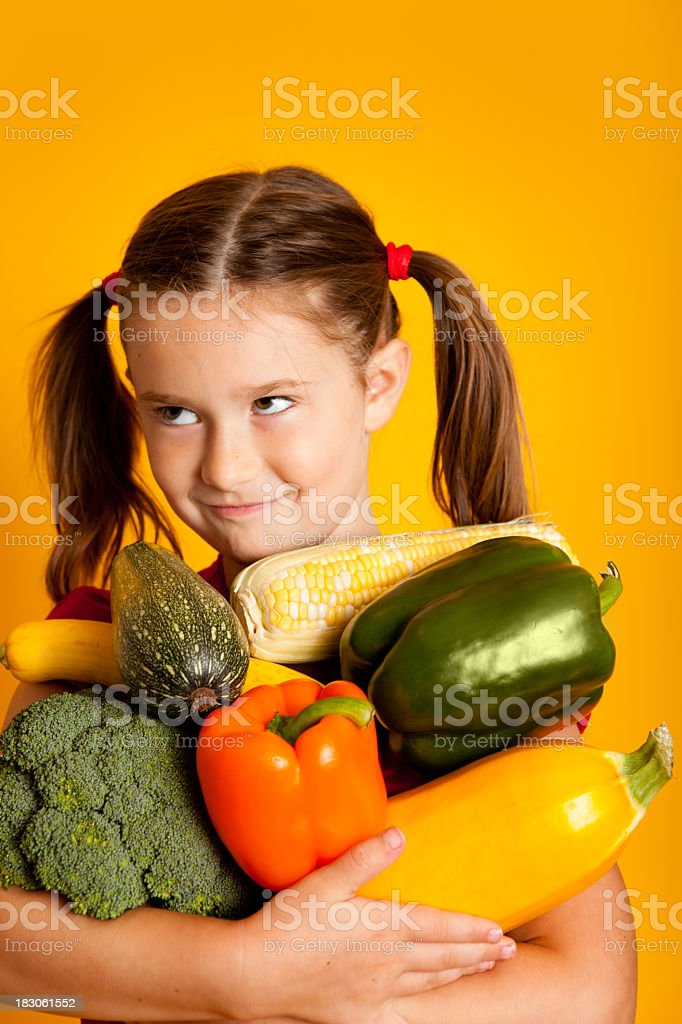 Young Girl Holding Vegetables, Bell Peppers, Broccoli, Squash, Zucchini, Corn royalty-free stock photo