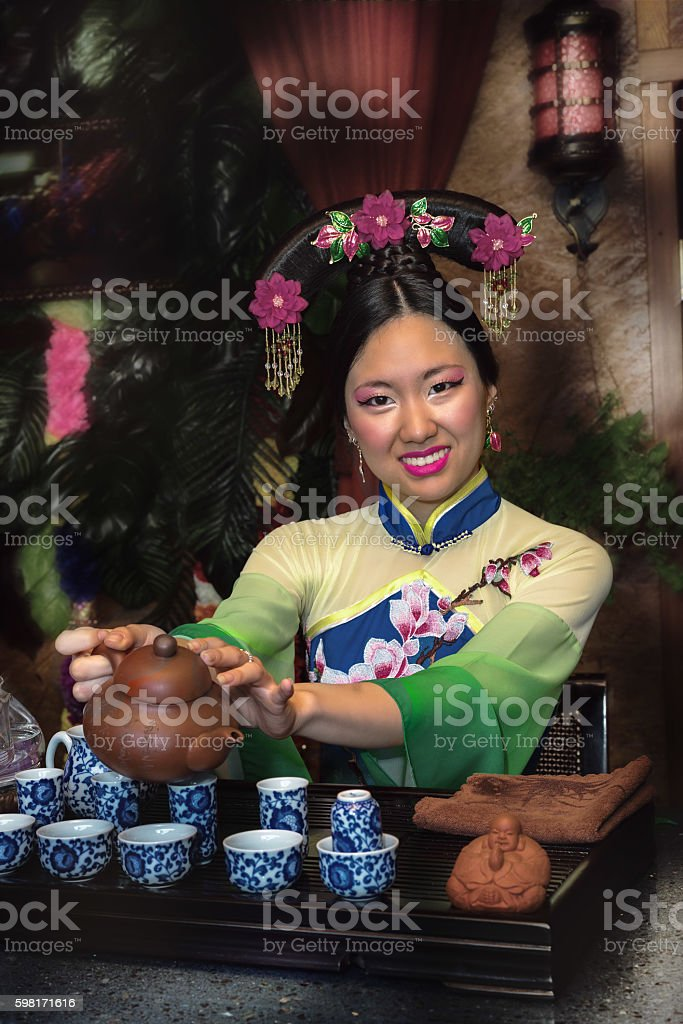 young girl holds a Chinese tea ceremony stock photo