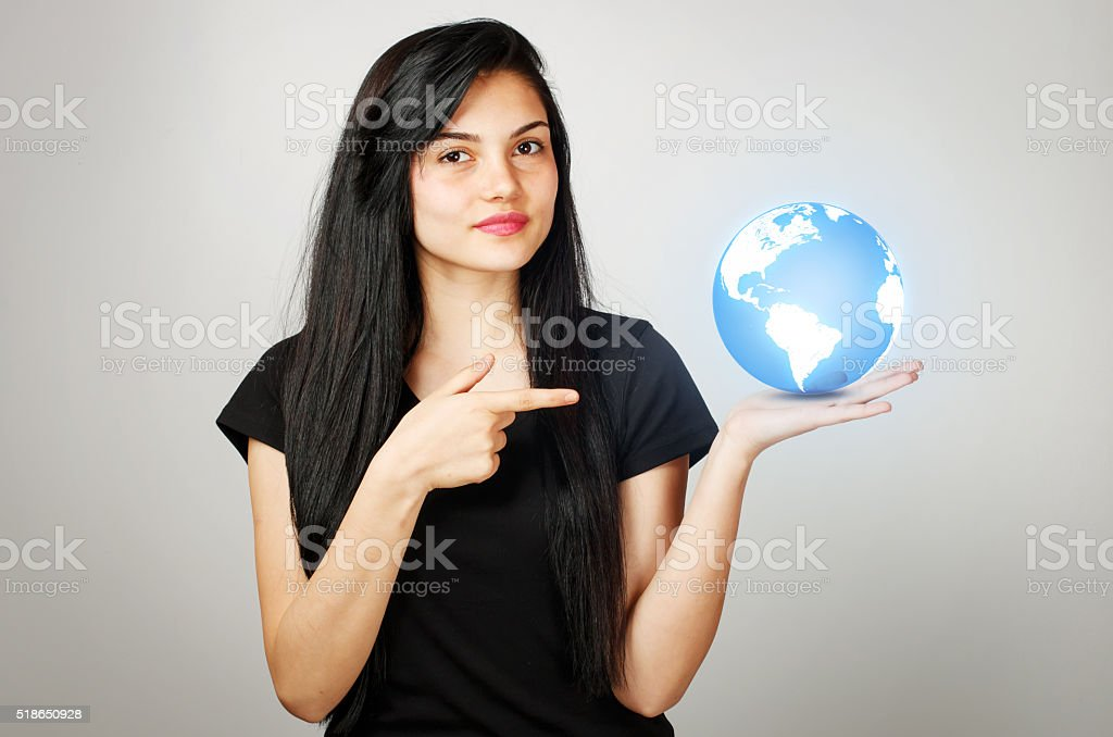 Young girl holds a world globe stock photo