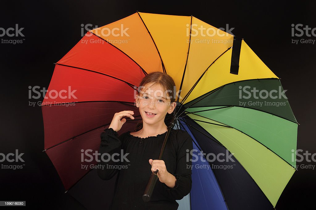 Young girl holds umbrella royalty-free stock photo