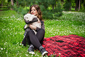 istock young girl hugs her dog in park on sunny day 533577742