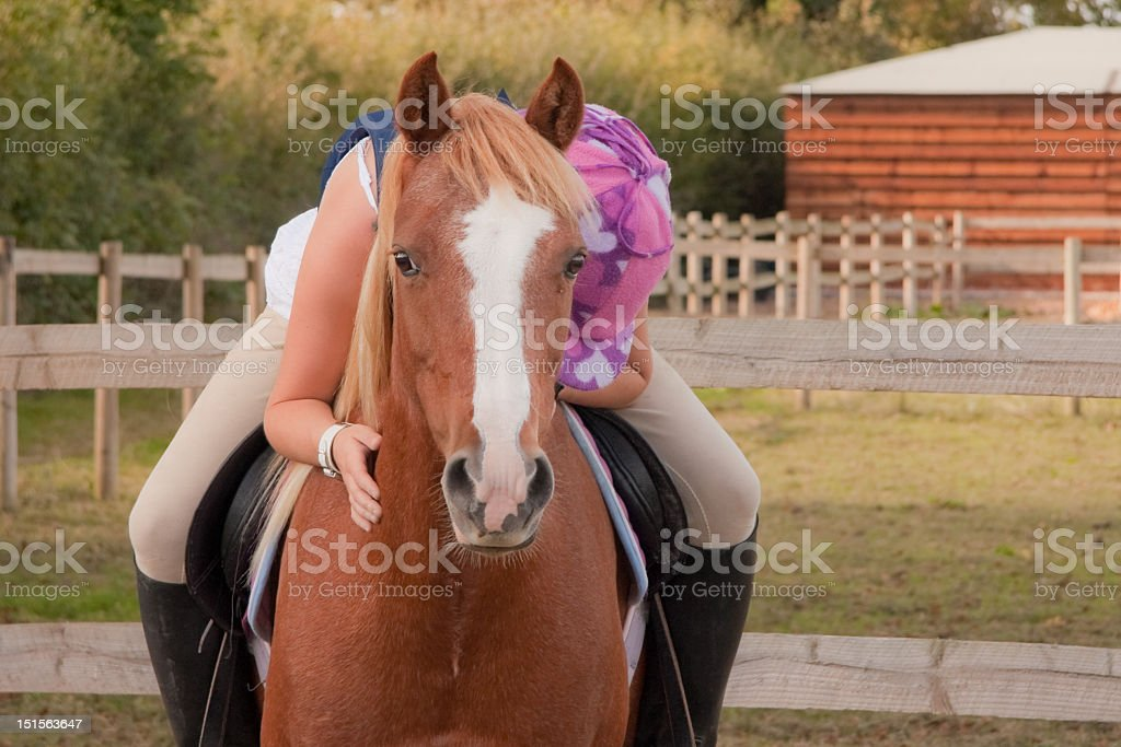 young girl hugs her pony royalty-free stock photo