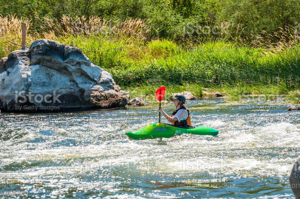 A young girl improves her skills in running a kayak. Kayaking is an extreme sport and recreation. stock photo