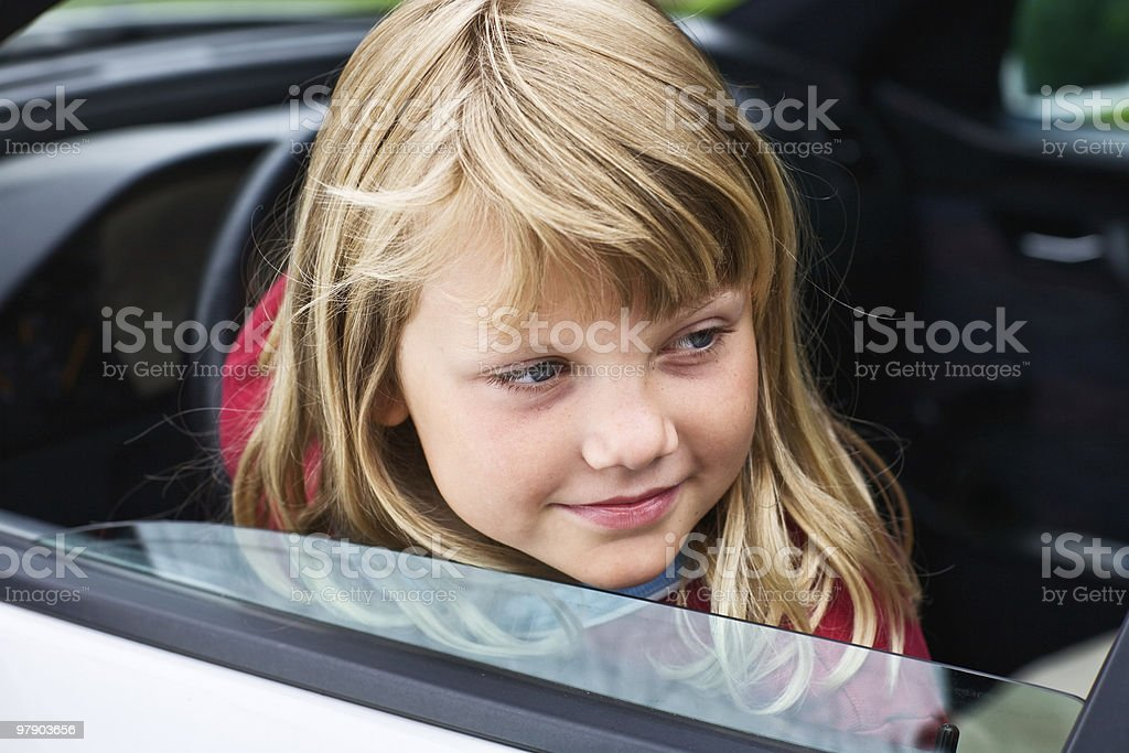 Young girl in a car royalty-free stock photo