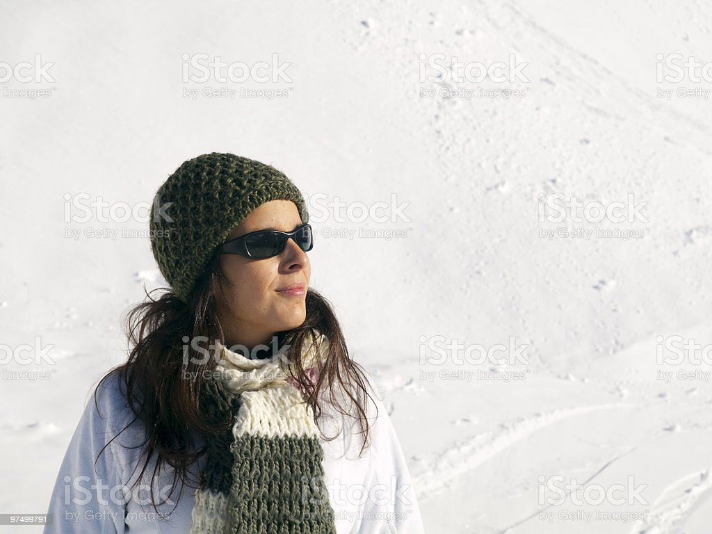 Young girl in a snowy background royalty-free stock photo