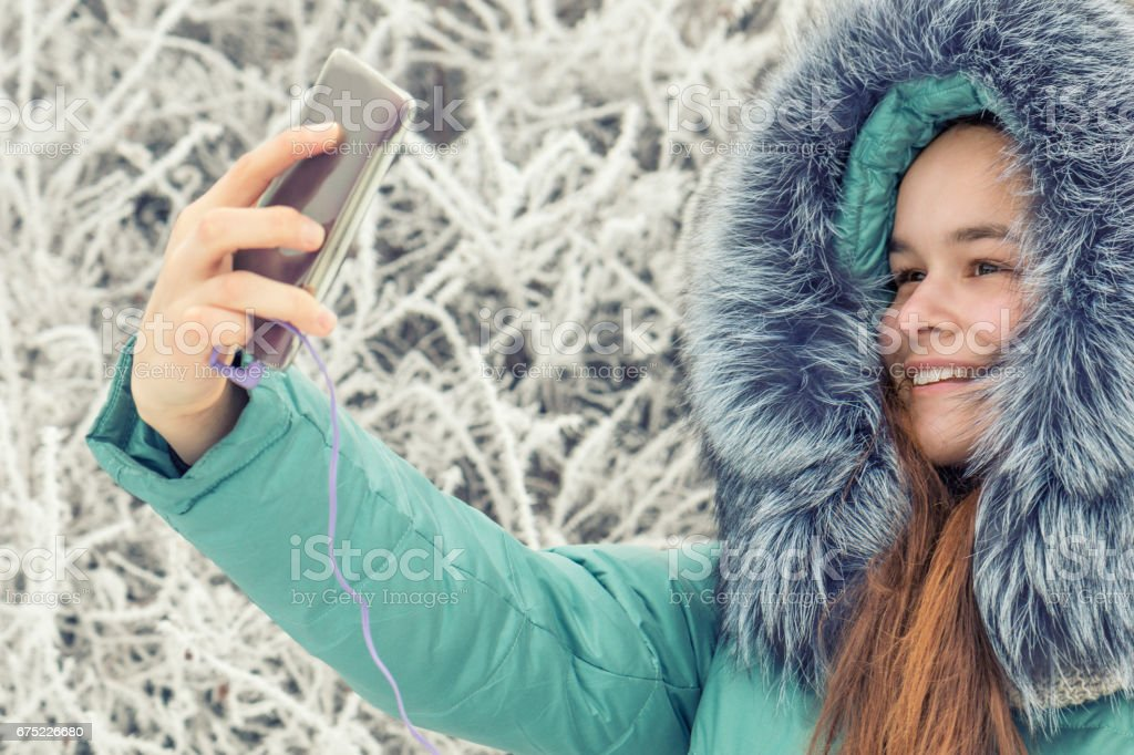 Young girl in a winter park near river royalty-free stock photo