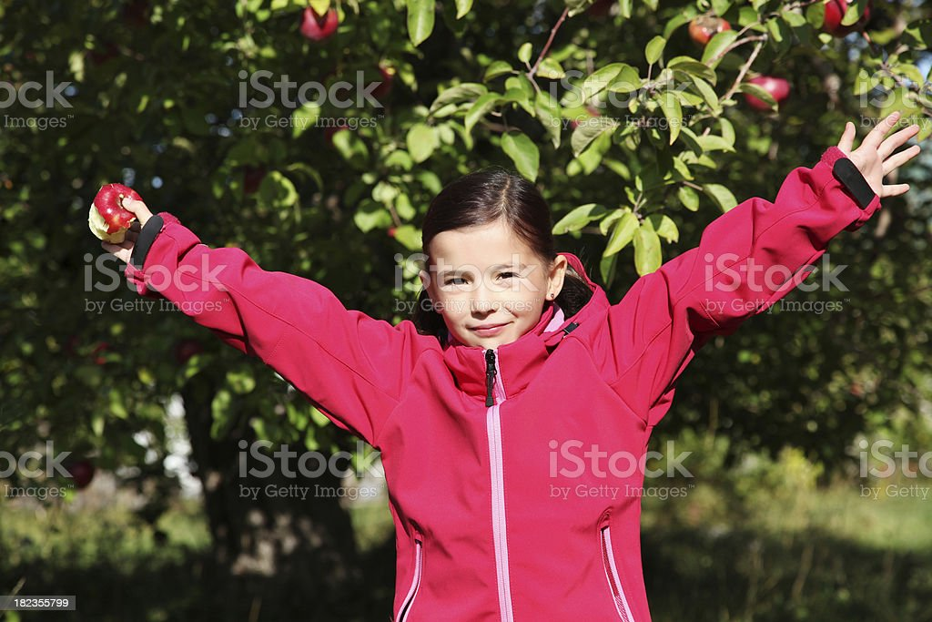 Young girl in an orchard royalty-free stock photo