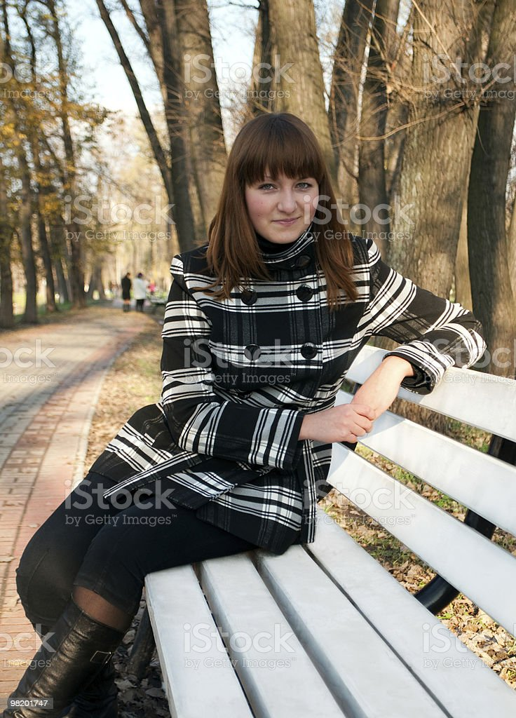 Young girl in autumn park royalty-free stock photo