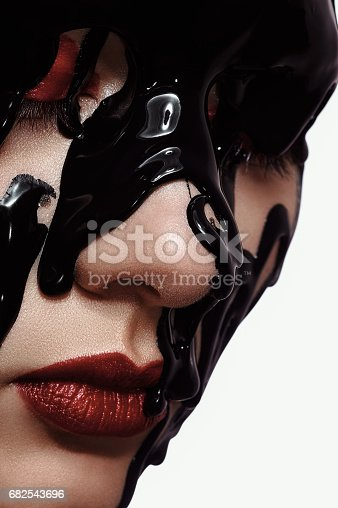 istock Young Girl in black Paint 682543696