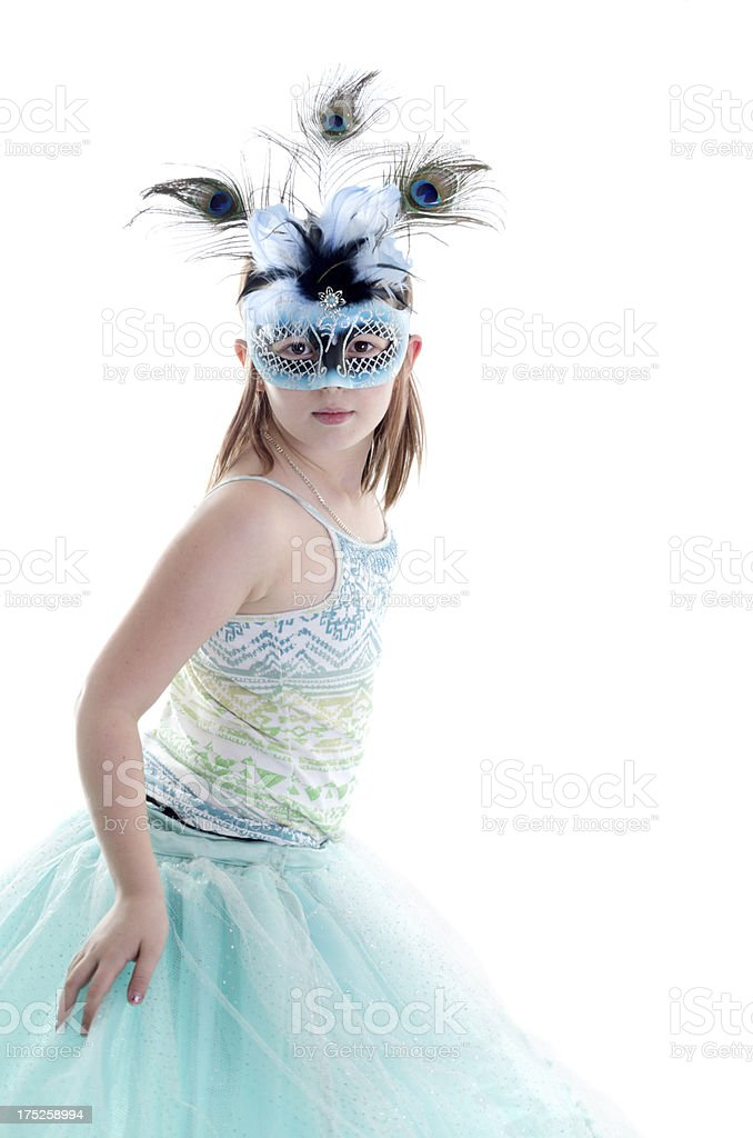 Young girl in blue and black mask dancing. royalty-free stock photo