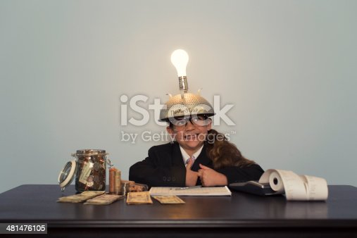 480585411 istock photo Young Girl in Business Suit Wearing Thinking Cap 481476105