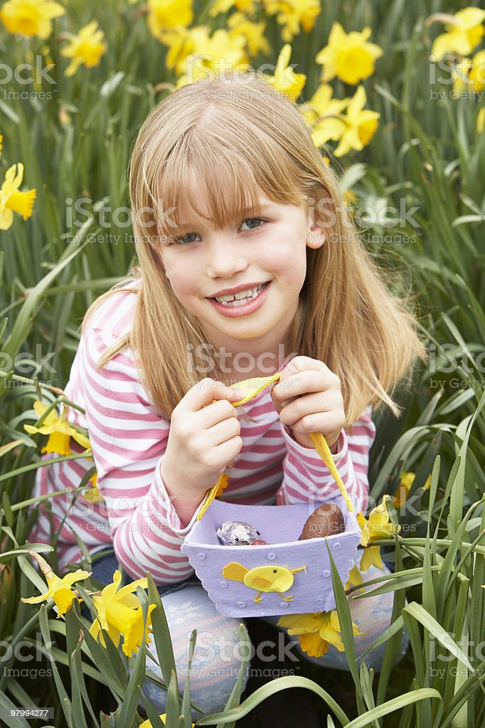 Young Girl In Daffodils At Easter royalty-free stock photo