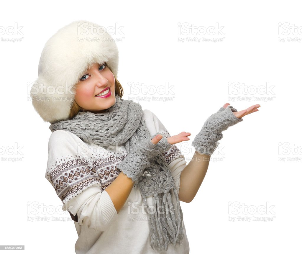 Young girl in fur hat shows welcome gesture royalty-free stock photo