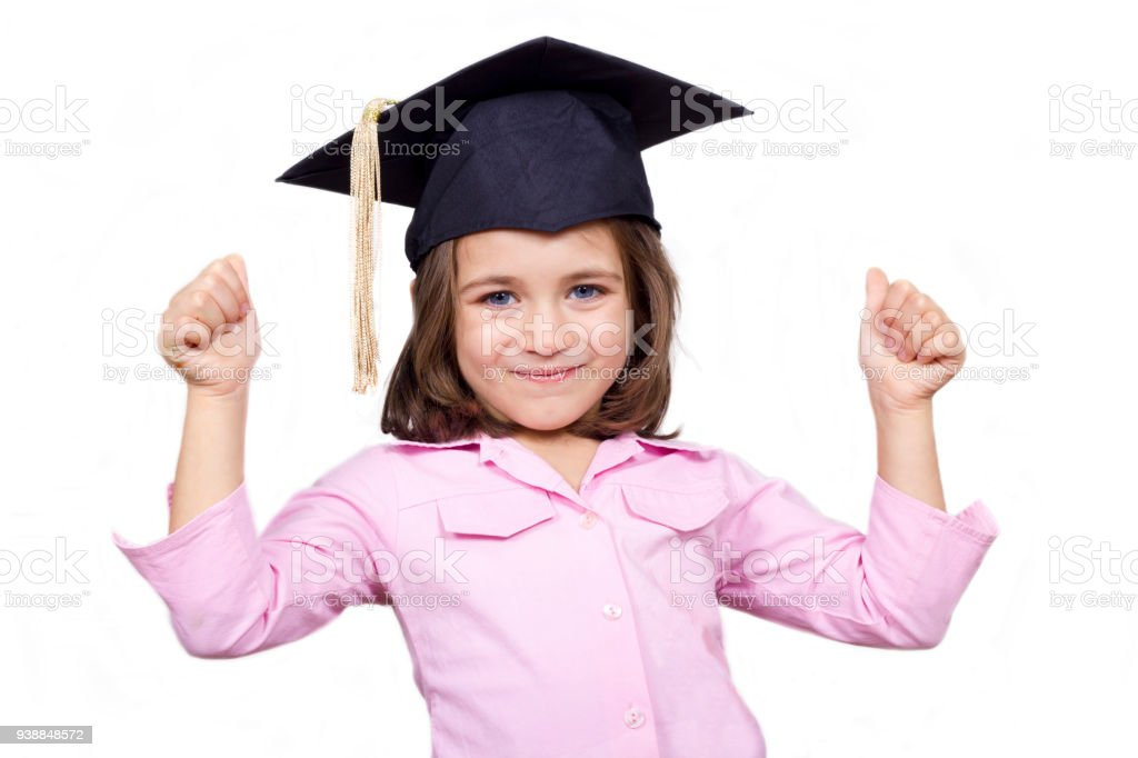 aaeaeab173e Young Girl In Graduation Cap And Gown Pointing Stock Photo   More ...