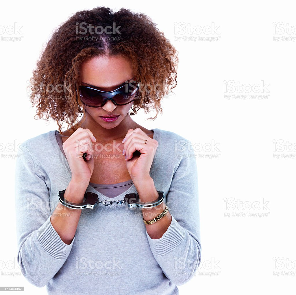Young girl in handcuffs isolated on white background stock photo