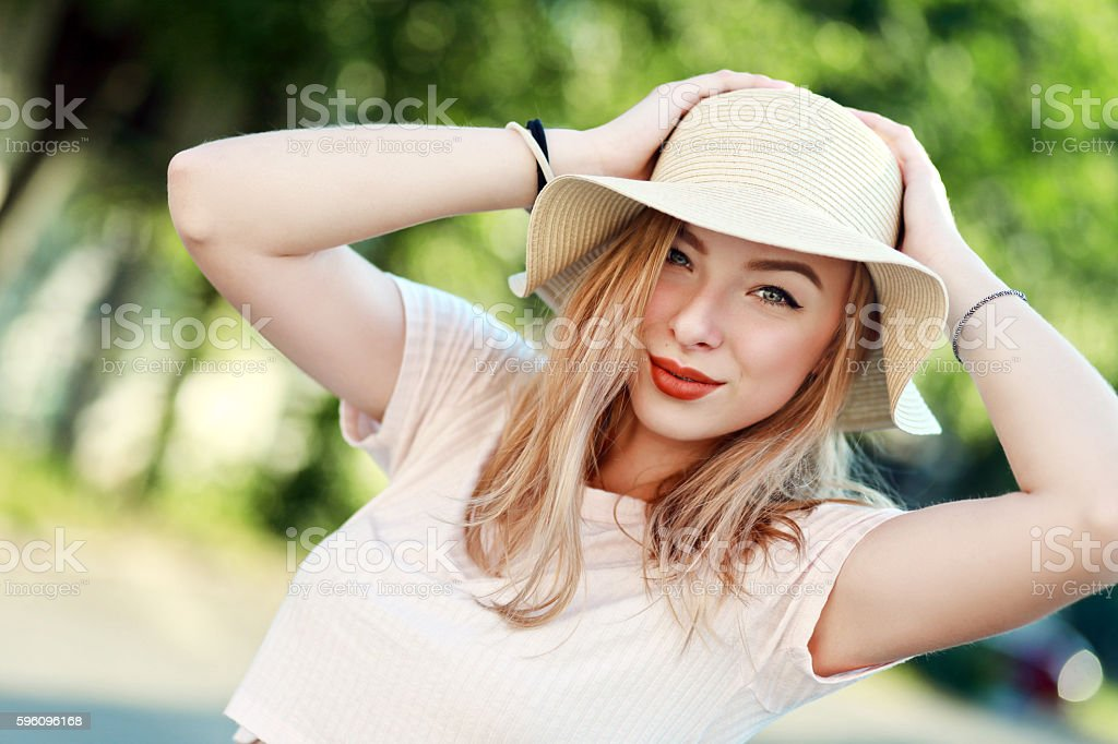 young girl in hat smiling royalty-free stock photo
