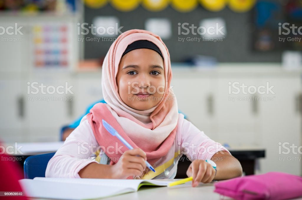 Young girl in hijab at school stock photo