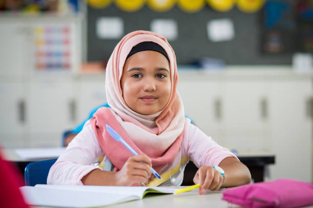 young girl in hijab at school - arabic girl stock photos and pictures