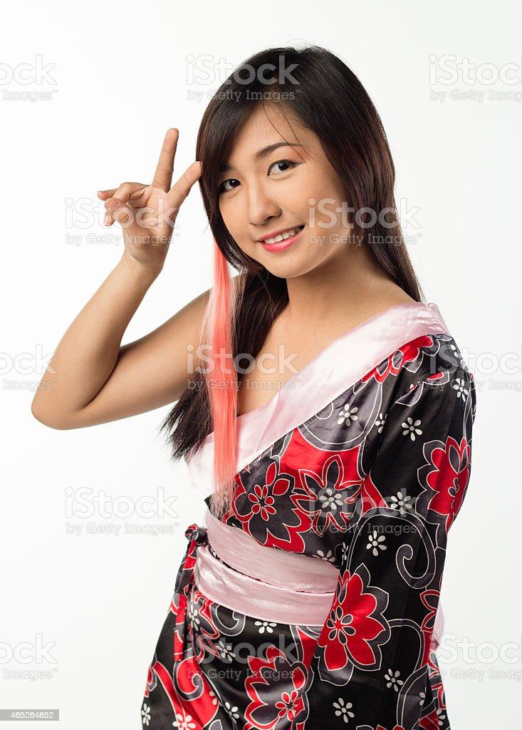 young girl in kimono posing stock photo