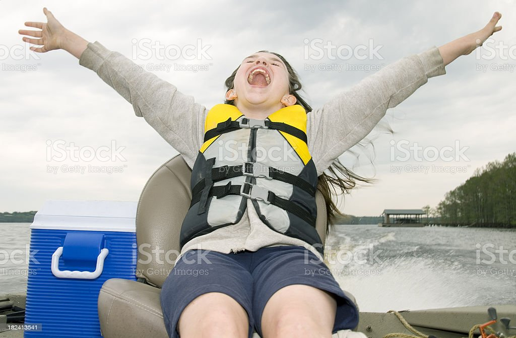 Young Girl in Life Jacket on Boat stock photo