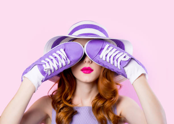 Young girl in purple clothes with shoes stock photo