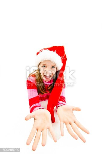 istock Young girl in red Santa hat, looking up in camera 500295220