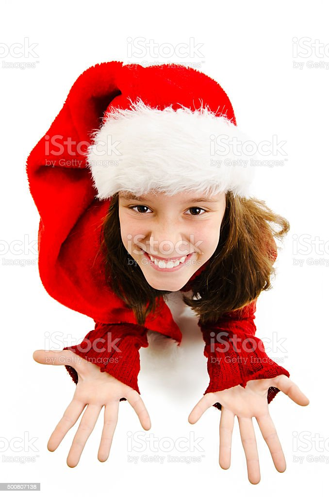 Young girl in red Santa hat, looking up in camera stock photo