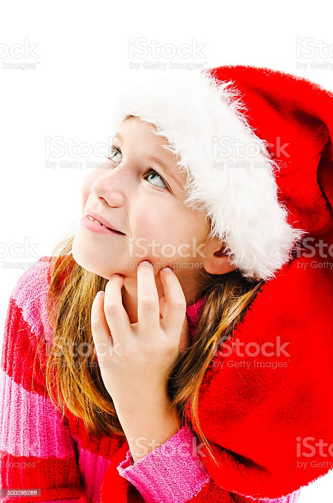 Young girl in red Santa hat, looking up stock photo