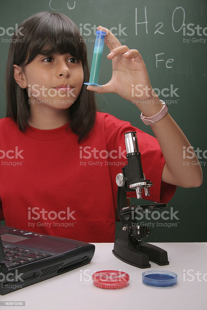 Young girl in science class royalty-free stock photo