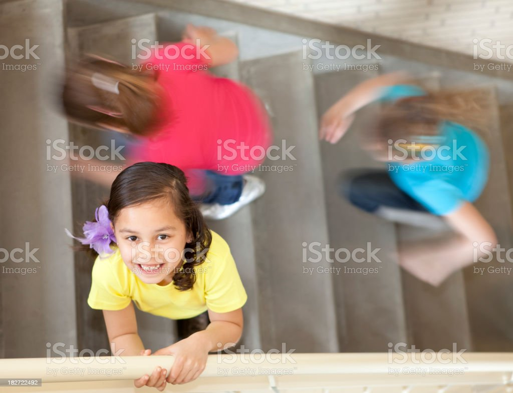 Young girl in staircase stock photo