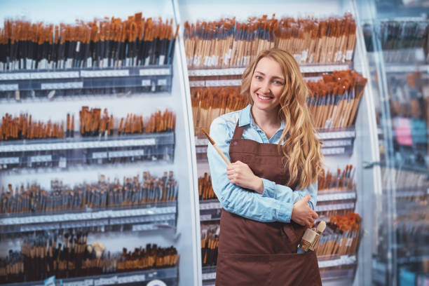 Young girl in the art store stock photo