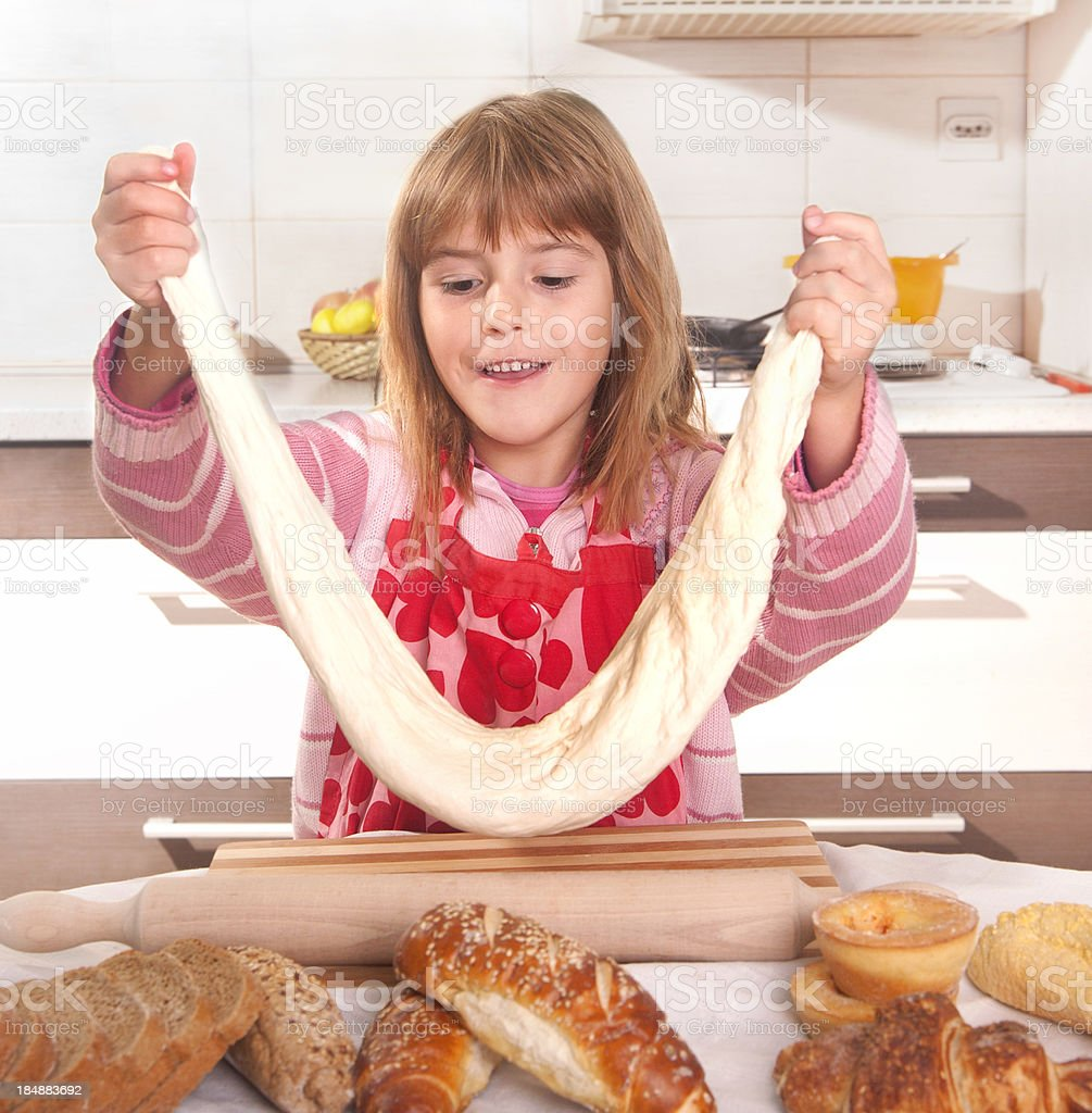 Young girl in the kitchen royalty-free stock photo