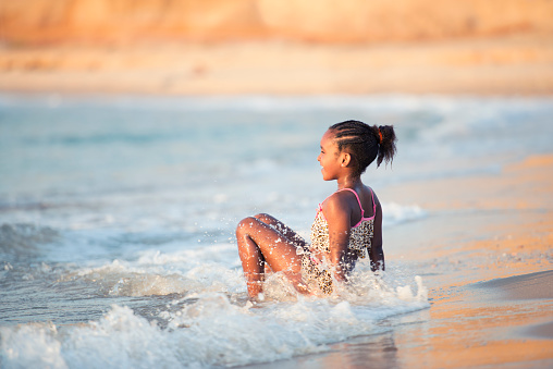 617378218 istock photo Young girl in the Mediterranean sea. 1001653454