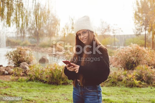 969233490 istock photo Young girl in the park 1203001331