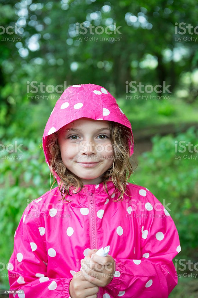 Young girl in the rain stock photo