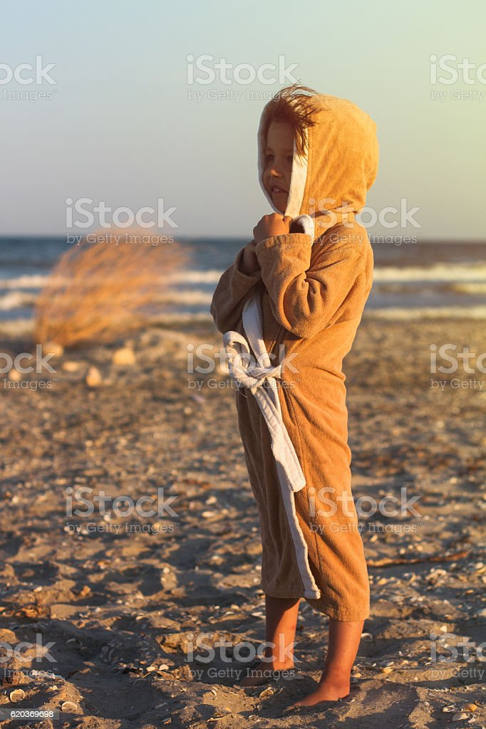 young girl in towel at the seaside foto de stock royalty-free